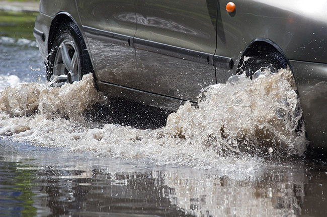 Possible auto injuries and whiplash driving on flooded streets